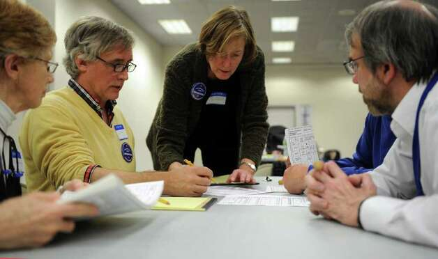 Kath Burgweger, center, helps counters as they tabulate ballots at the City Hall Annex on Thursday, November 2, 2010. Photo: Lindsay Niegelberg / Connecticut Post