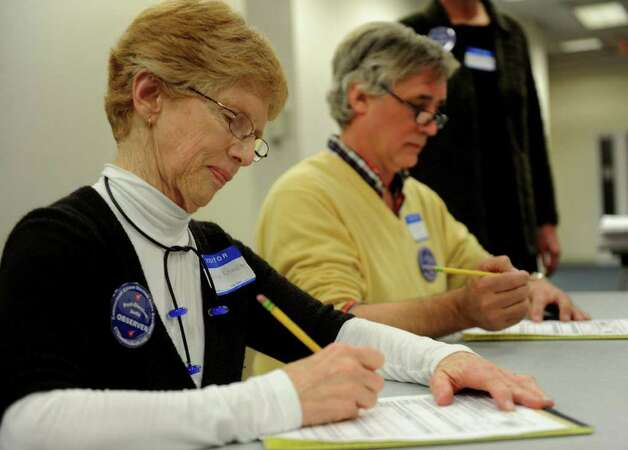 Nancy Rosenbaum, left, and Cyrus Miller, right, help re-count ballots at the City Hall Annex on Thursday, November 2, 2010. Photo: Lindsay Niegelberg / Connecticut Post