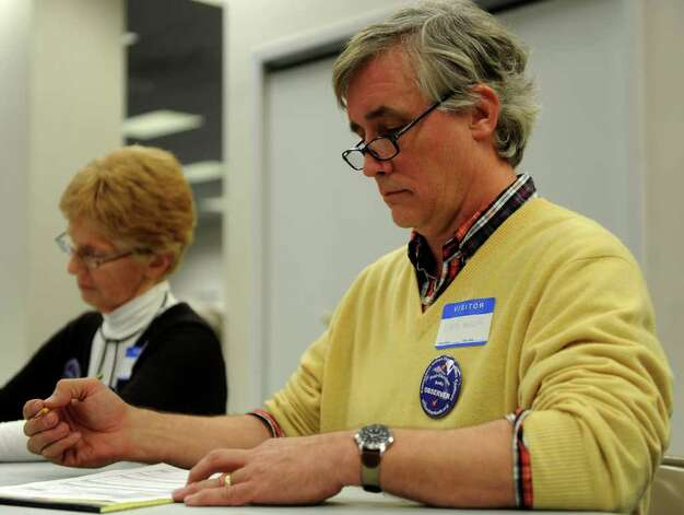 Cyrus Miller, right, and Nancy Rosenbaum, left, help re-count ballots at the City Hall Annex on Thursday, November 2, 2010. Photo: Lindsay Niegelberg / Connecticut Post