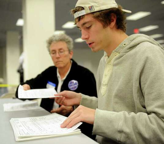 Sherman Burgweger helps re-count ballots at the City Hall Annex on Thursday, November 2, 2010. Photo: Lindsay Niegelberg / Connecticut Post