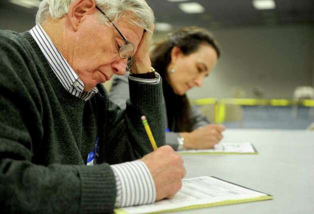 Bill Bunnell helps re-count ballots at the City Hall Annex on Thursday, November 2, 2010. Photo: Lindsay Niegelberg / Connecticut Post