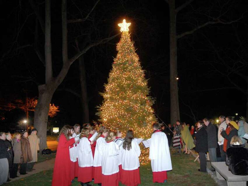 The Christmas tree was lit in front of Christ Church Greenwich as the St. Cecelia Choir of Girls performed during an interfaith Celebration of Light, put on by Temple Sholom and Christ Church in front of Christ Church, Greenwich, Thursday evening, Dec. 2, 2010.