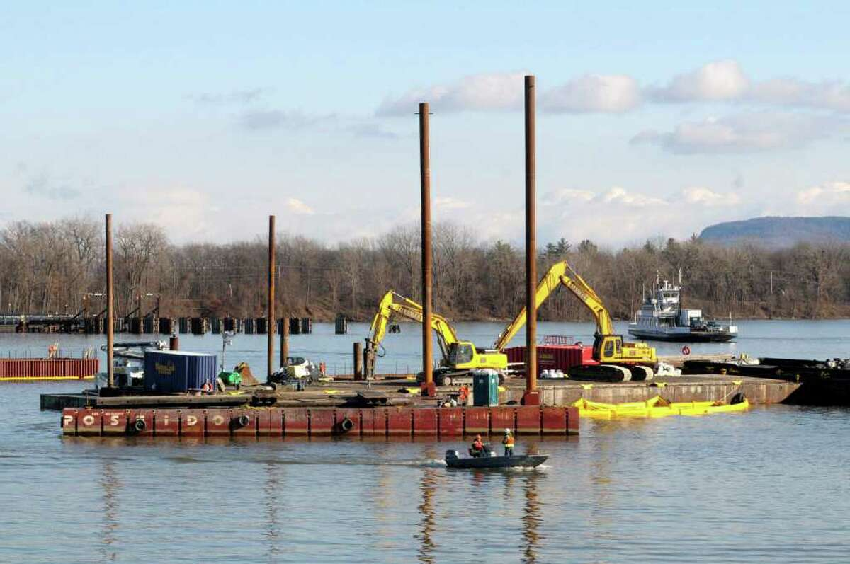 Workers use boats to get around the site as construction on the new Lake Champlain bridge continues on Thursday, Dec. 2, 2010, in Crown Point. (Paul Buckowski / Times Union)