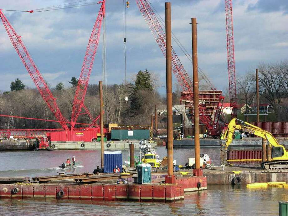 Workers use boats to get around the site  as construction on the new Lake Champlain bridge continues on Thursday, Dec. 2, 2010, in Crown Point.  (Paul Buckowski / Times Union) Photo: Paul Buckowski / 00011262A