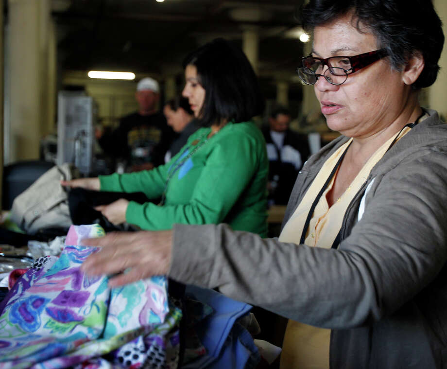 SAMMinistries job trainee Nance Marmolejo sorts donated clothing at the HAven for Hope campus. Photo: Micheal Miller, Micheal Miller/Express-News
