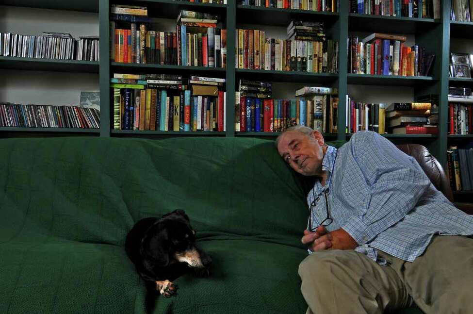 Retired WNYT Channel 13 anchor Ed Dague sits with his beloved 12 year old dachshund Nathan (female ) as he talks about his new memoir,