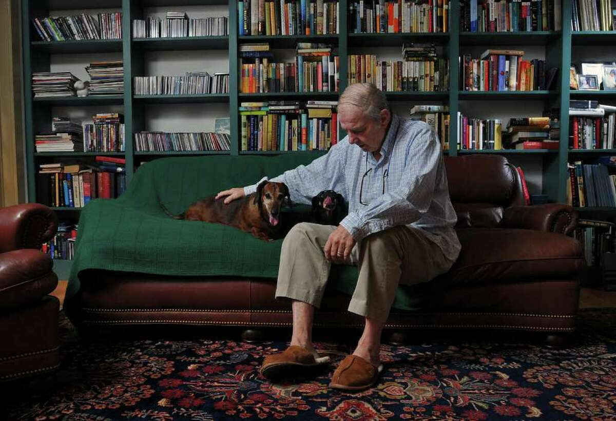 Retired WNYT Channel 13 anchor Ed Dague sits with his beloved 12 year old dachshunds Katherine, left, and Nathan, (both female ) as he talks about his new memoir,