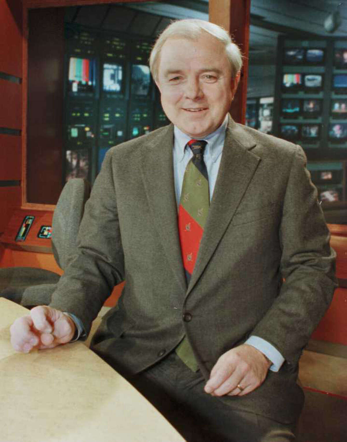 Ed Dague, pictured in December 1995, at the WNYT Channel 13 news studio in Menands. He was considered a voice of authority with a non-nonsense style. (File photo)