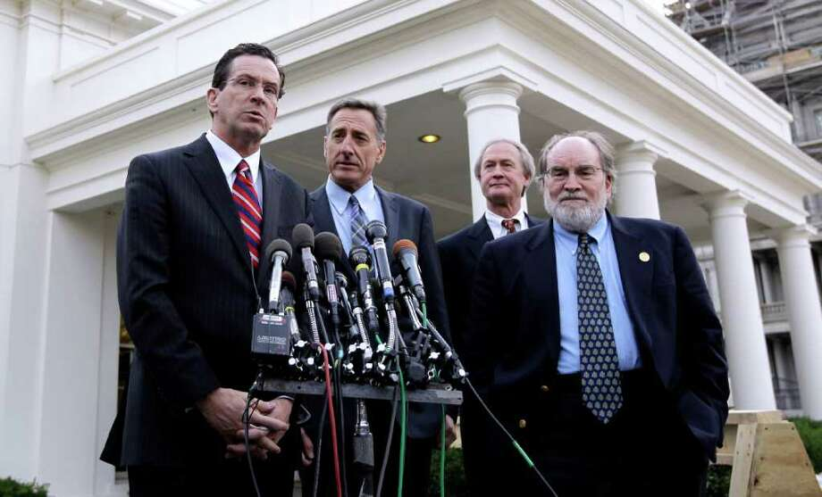 Connecticut Gov.-elect Dan Malloy, left, accompanied by fellow incoming governors, speaks outside the White House in Washington, Thursday, Dec. 2, 2010, following their meeting with President Barack Obama. From left are,, Malloy, Vermont Gov.-elect Peter Shumlin, Rhode Island Gov.-elect Lincoln Chafee, and Hawaii Gov.-elect Neil Abercrombie. Photo: Charles Dharapak, AP Photo/Charles Dharapak / AP