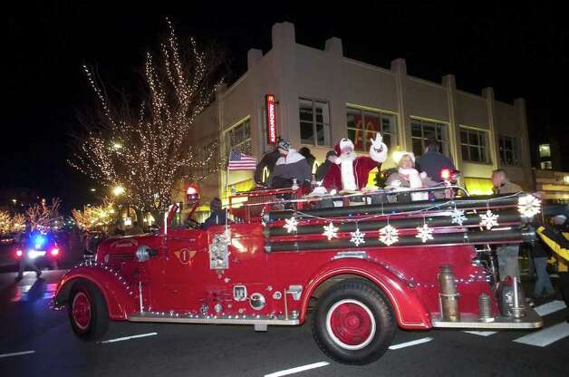 Santa rides a fire truck to Latham Park for the city's tree lighting last year during the Downtown Special Services District's annual Heights and Lights event in downtown Stamford. Santa returns this year at 4:30 p.m., Sunday, Dec. 5. Photo: File Photo / Stamford Advocate File Photo