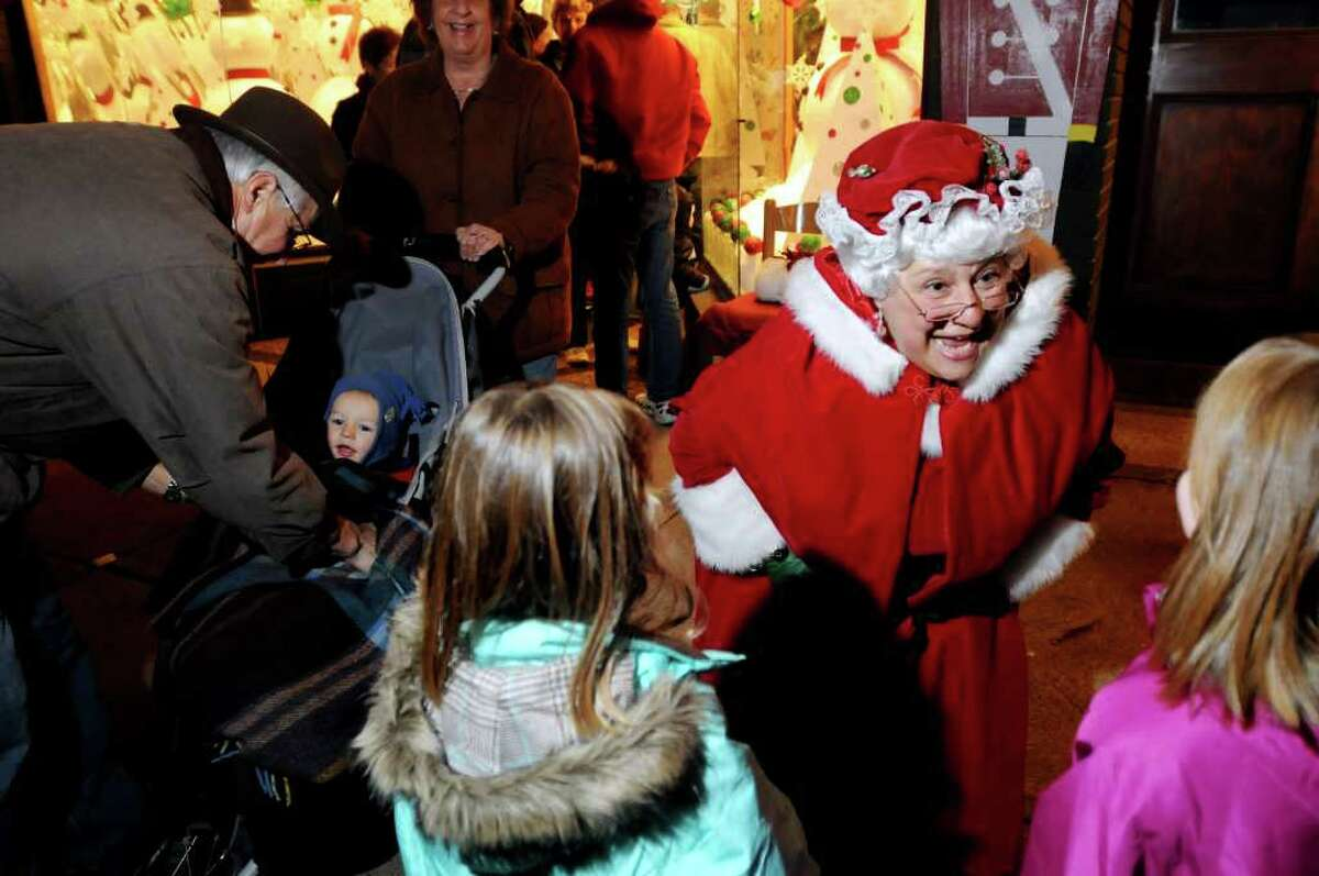 JoAnn McGraw, dressed as Mrs. Claus, delights children with her stories during the Victorian Streetwalk on Thursday, Dec. 2, 2010, in Saratoga Springs, N.Y.