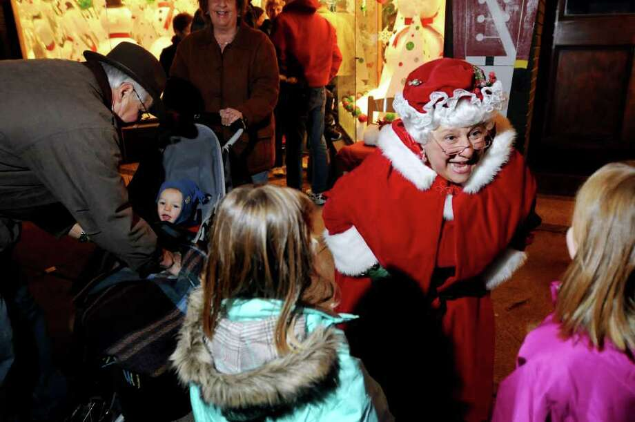 "JoAnn McGraw, dressed as Mrs. Claus, delights children with her stories during the Victorian Streetwalk on Thursday, Dec. 2, 2010, in Saratoga Springs, N.Y. ""Everybody smiles when they see Mrs. Claus,"" she said. (Cindy Schultz / Times Union) Photo: Cindy Schultz"