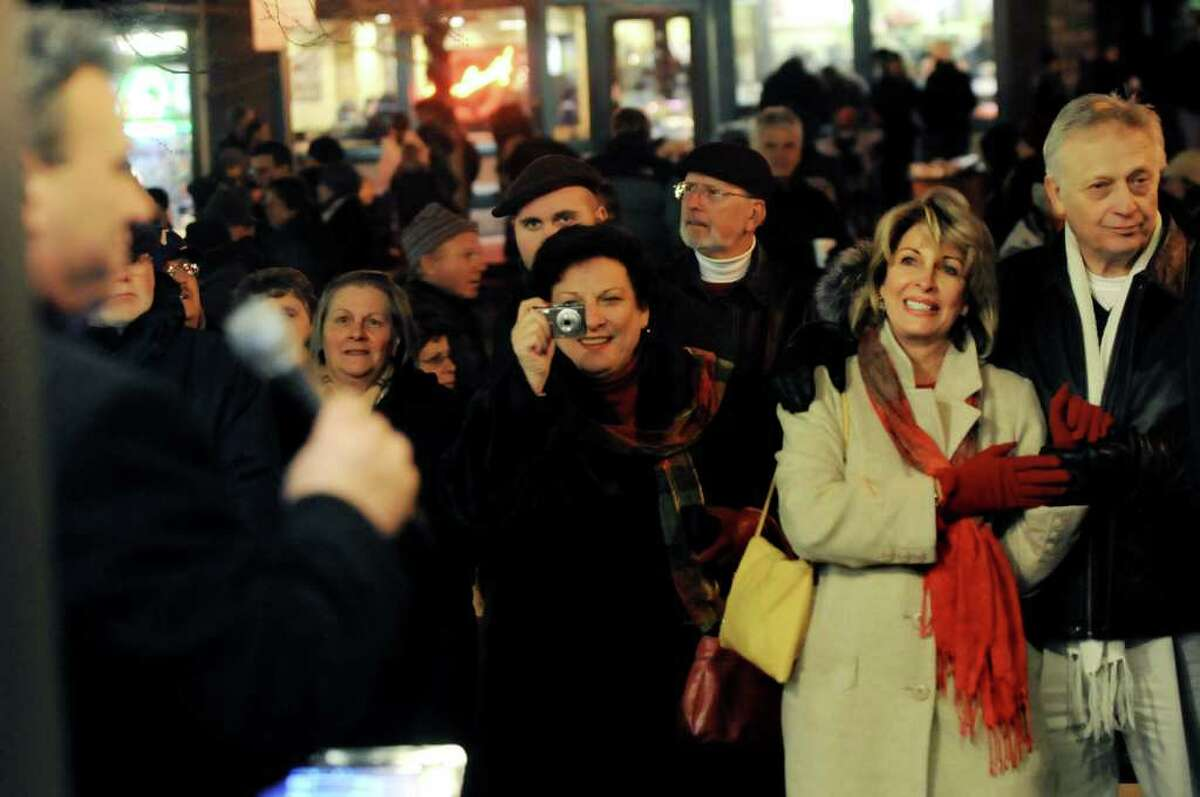 Chris and Harriet Bast of Rexford, right, join others on Broadway as they listen to singer Nick Coluccio during the Victorian Streetwalk on Thursday, Dec. 2, 2010, in Saratoga Springs, N.Y. (Cindy Schultz / Times Union)