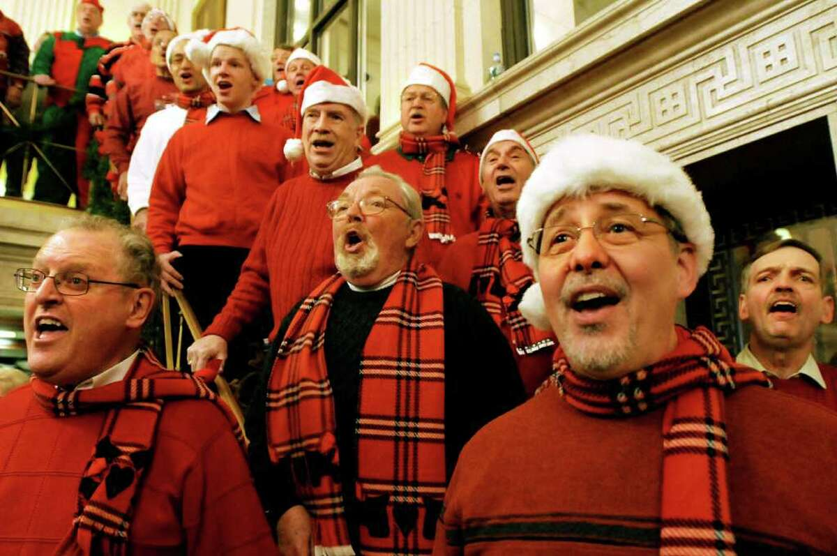 Racing City Chorus singers, ranging in age from 14 to 80 years old, perform holiday songs during the 24th annual Victorian Streetwalk on Thursday, Dec. 2, 2010, in Saratoga Springs, N.Y. (Cindy Schultz / Times Union)