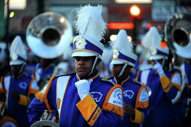 The Ozen High School bands leads the way for Beaumont's annual Christmas parade through downtown Saturday night. Guiseppe Barranco/The Enterprise / Beaumont