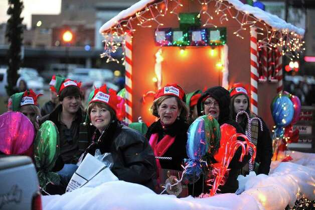 Crowds lined Beaumont's downtown streets Saturday night to catch candy canes and the holiday spirit during the city's annual Christmas parade. Guiseppe Barranco/The Enterprise / Beaumont
