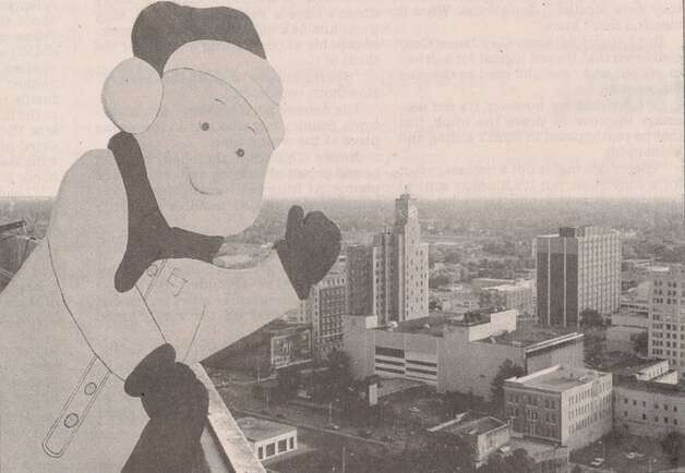 EJ, the mascot for the Empty Stocking Fund, waves from the roof of the Enterprise. File photo Nov. 12, 1999