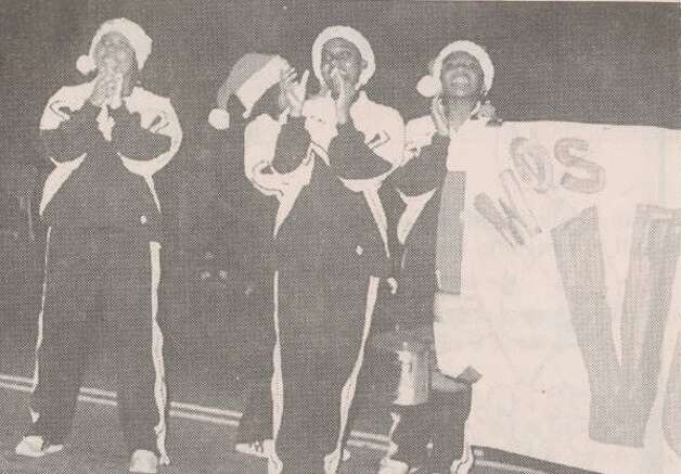 """Members of the West Orange-Stark drill team show their school spirit during the Christmas parade."" File photo Dec. 8, 1999"