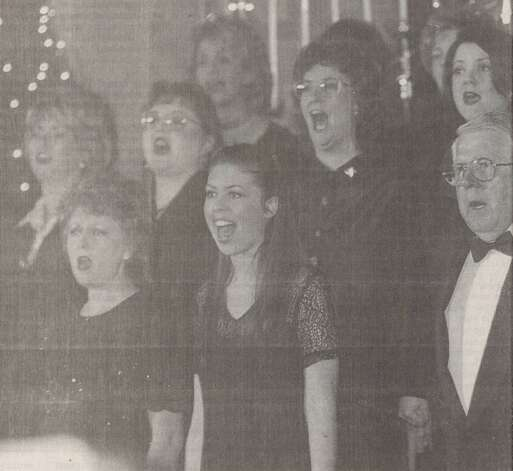 """The choir of Cathedral in the Pines rehearses Thursday for a Christmas Eve service. Everett Forner, the church's pastor, said the Christmas theme 'Come As you Are' is meant to encourage people to reconnect with the church."" File photo Dec. 25, 1999"
