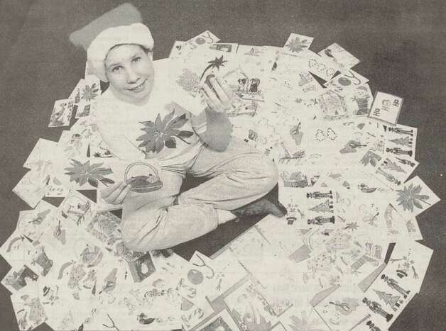 """Audie McDonald, 14, sits among cards that will be offered at the C.P Rehabilitation Center's annual holiday greeting card sale."" File photo Nov. 6, 1998"