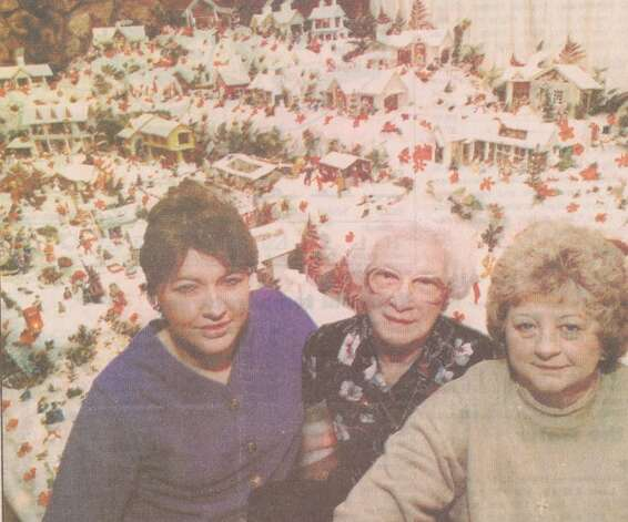 """Lucille Babin, center, started building the Christmas village in 1940. Her daughter-in-law Gloria Babin, right, and Gloria's daughter-in-law Dana Haynes continue the tradition."" File photo Dec. 23, 1996"