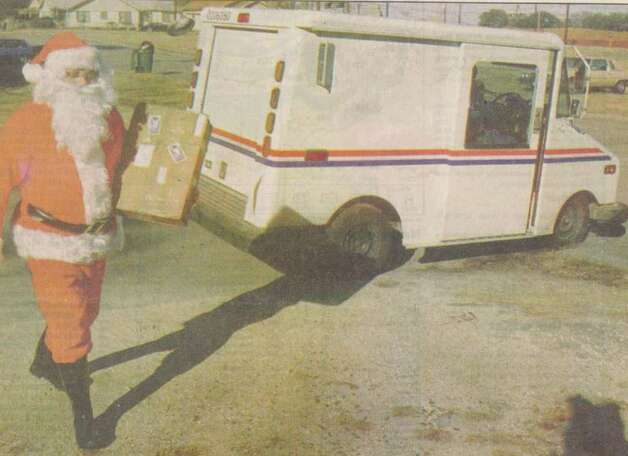"""Don Sanford leaves his truck to make a delivery Wednesday."" File photo Dec. 26, 1996"