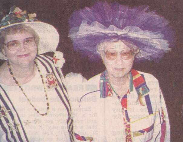 """Nora Bingham and Ina Mae Covington wait backstage for their appearance in the annual Ron Lewis Senior Citizen Hat Parade. Bingham won fifth place and $15. Covington won sixth and $10."" File photo Nov. 29, 1995"