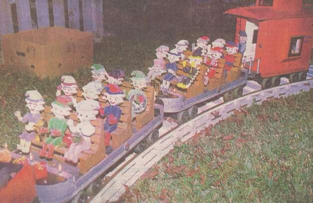 """The elves take a ride on the motorized train created by Liles and Nita Wolfford."" File photo Dec. 10, 1995"
