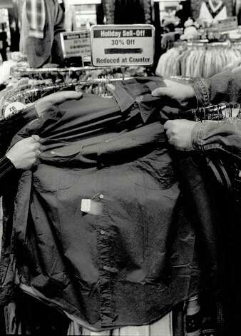 """Tussles over merchandise are not an improbability the day after Christmas."" File photo Dec. 19, 1995"