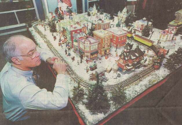 """Orange Mayor Dan Cochran exhibits his 'second city': his Christmas village, made up primarily of ceramic figures and buildings."" File photo Dec. 20, 1995"