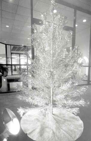 """Michael Lee's tree and color wheel decorate his office."" File photo Dec. 21, 1995"