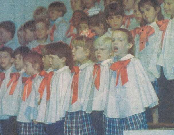 """The choir sings at All Saints School's annual presentation of the Christmas story Wednesday night."" File photo Dec. 25, 1995"