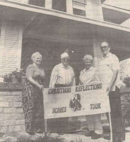 """Mary Buchanan, Joe Loidold, Pat Loidold and Gerald Buchanan stand in front of a tour home."" File photo Nov. 18, 1994"