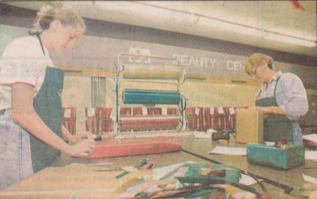 """Heather Fesco, left, and Sue Fesco, both of Sour Lake, wrap Christmas purchases Friday at Parkdale Mall."" File photo Nov. 26, 1994"