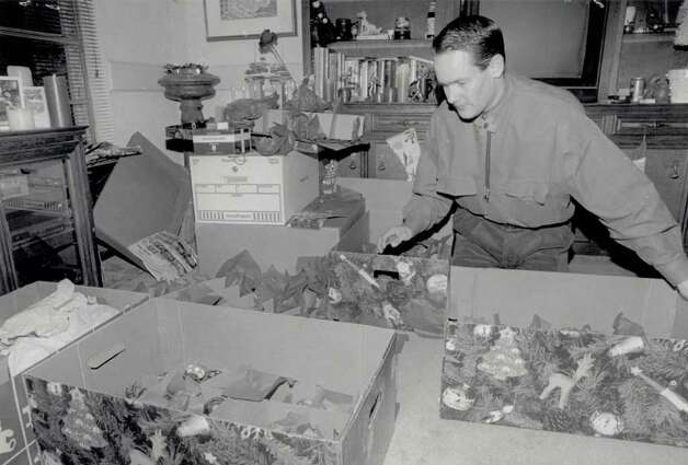 """Darrell Troppy unpacks boxes full of his '1000' ornaments for his guests to unpack and put on his tree during the party."" File photo Dec. 13, 1994"