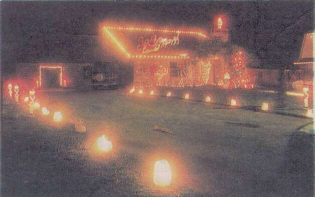 """This house in Nederland features luminaries along the driveway that add a special touch to the decorations."" File photo Dec. 16, 1994"