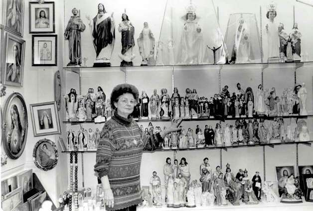 """Anne Angell with some of the religious items in her store, Unique Gift Corner."" File photo Dec. 17, 1994"