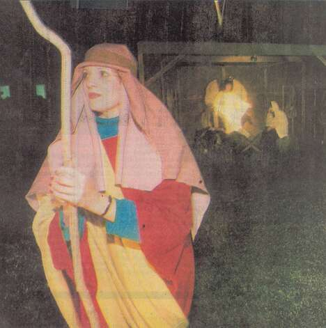 """Mariann Benko portrays a shepherd in the nativity scene sponsored by several Nederland churches which combine efforts for the holidays."" Dec. 25, 1994"