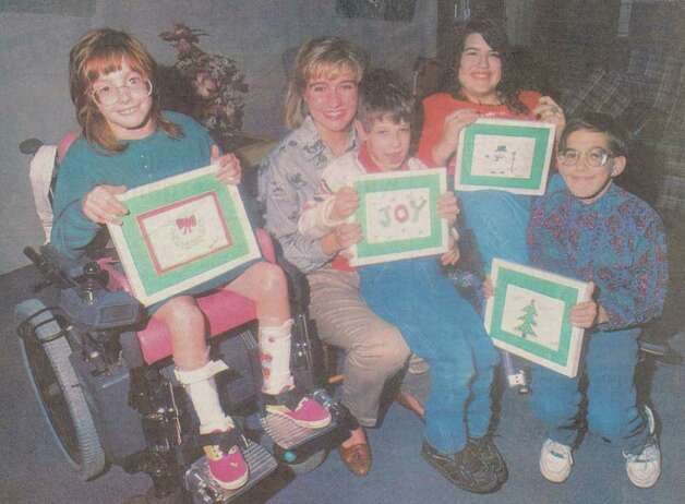 """Beaumont CP Rehabilitation Center participants Shelby Evans, from left, organizer Keely Windham, Kirk Morris, Jennifer Garza and Michael Court smile as they display their work. Windham, a West Brook cheerleader spearheaded the project."" File photo Nov. 7, 1993"