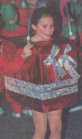 """Kim Bayliss was one of dozens from the Lorna Badon School of Dance who danced through the parade in package costumes."" This is at the 45th annual Jaycees Christmas Parade in Orange. File photo Dec. 15, 1993"
