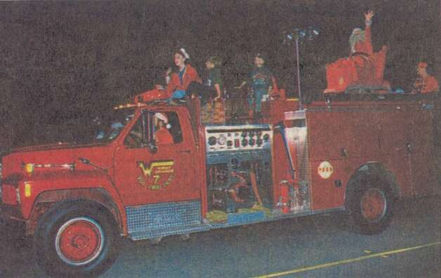 """Santa and several of his 'elves' took a ride on fire truck courtesy of West Orange Volunteer Fire Department."" This is at the 45th annual Jaycees Christmas Parade in Orange. File photo Dec. 15, 1993"