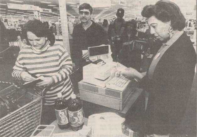 """Target employee Sharon Davis credits Priscilla Venza, left, of Beaumont for items she was returning to the store on Sunday afternoon."" File photo Dec. 27, 1993"