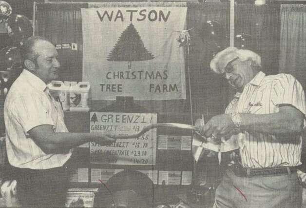 """Darrel Watson, owner of Watson's Christmas Tree Farm in Tyler, left, shows Dan Dellinger, president of the Texas Christmas Tree Growers Association, a rotary knife shearing trimmer for shaping trees."" The men were at a convention at the Holiday Inn Beaumont Plaza. File photo Sep. 26, 1992"