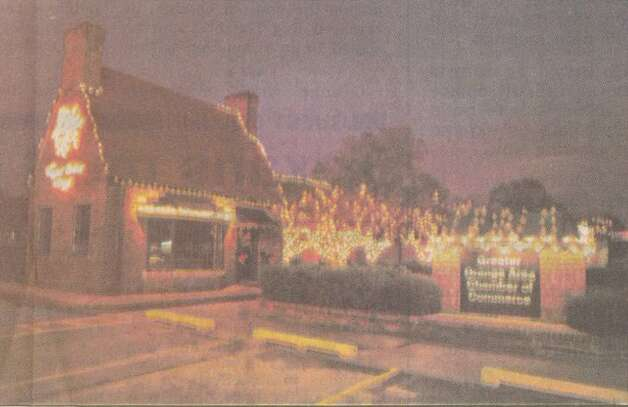 """The Greater Orange Area Chamber of Commerce building takes on a holiday look with a dazzling array of outdoor Christmas lights."" Dec. 2, 1992"