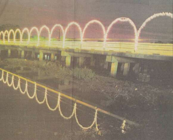 """Orange brightens up for the upcoming holiday season as 99 strings of lights are used on MacArthur Bridge for 'Lights on the Bayou.'"" File photo Dec. 2, 1992"