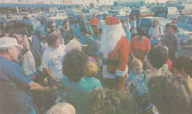 """Although strong winds changed his plans to parachute into the Golden Triangle, Santa Claus still made it here Friday with the help of the Beaumont Police Department. The department gave the jolly old elf a lift to Gateway Shopping City in one of its patrol cars. Children, naturally, were delighted."" File photo Nov. 30, 1991"