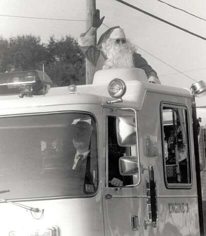 """Santa rides atop a fire truck at the very end of the Nederland Christmas Parade."" File photo Dec. 3, 1991"