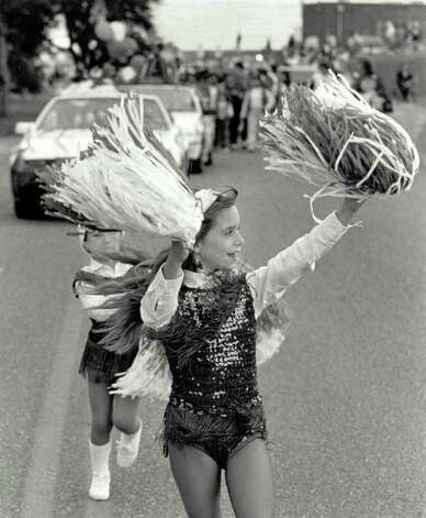 """Eight-year-old Krystal Hopkins sends out some Christmas cheer as a representative of Estrello School of Dance in the Port Arthur Christmas Parade."" File photo Dec. 7, 1991"