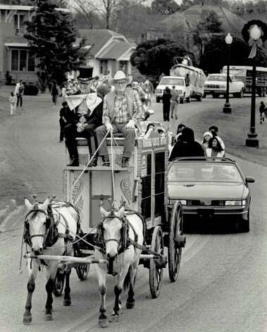"""A circus wagon from the Winfree Ranch makes its way down Lakeshore Dr. as part of the Port Arthur Christmas parade Saturday morning."" File photo Dec. 7, 1991"