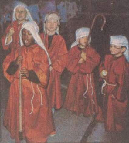 Shepherd boys lead the way for the Badon dancers' float at the 42nd annual Jaycees Parade in Orange. File photo Dec. 11, 1991
